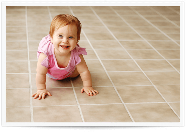 baby crawling on tile floor