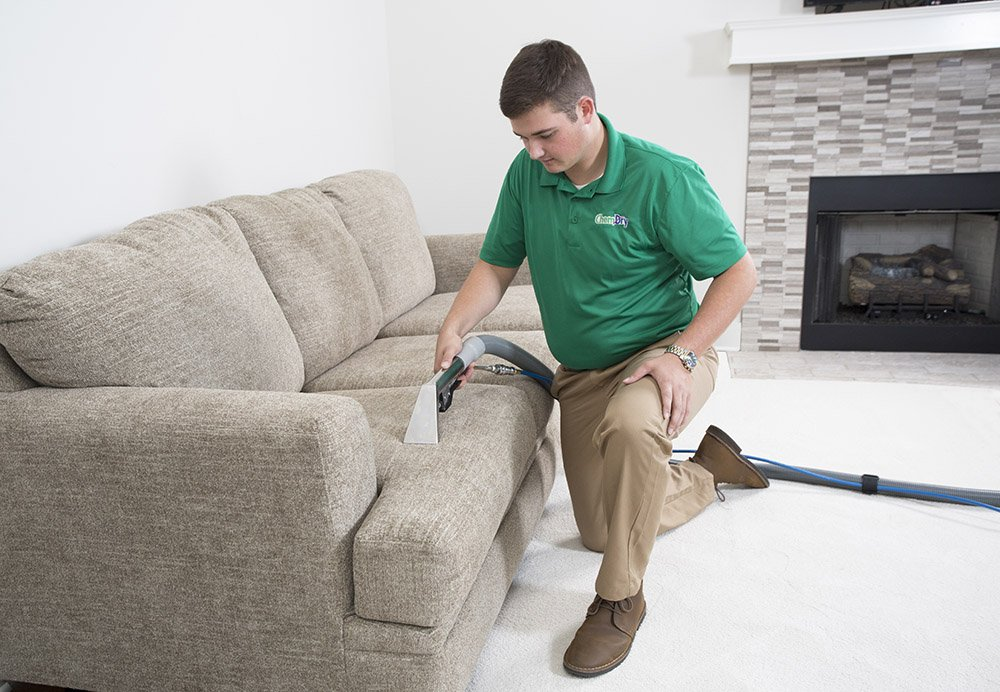 chem-dry tech performing upholstery cleaning in omaha