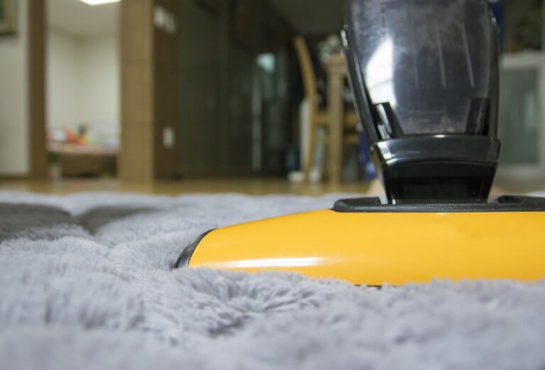 yellow vacuum cleaning gray carpets